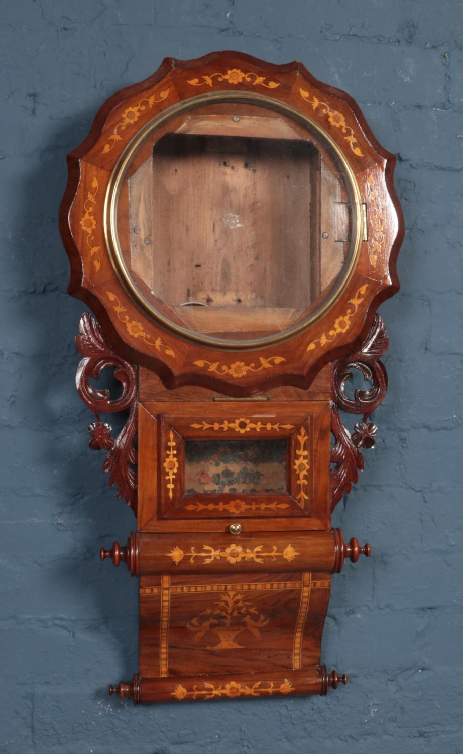 A late 19th century inlaid drop dial wall clock case. No movement or dial.