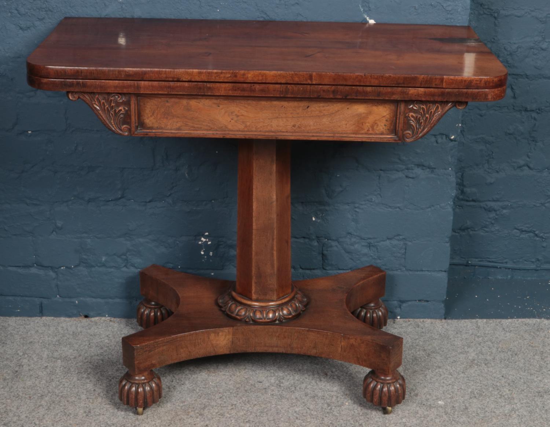 An early Victorian mahogany fold over card table.