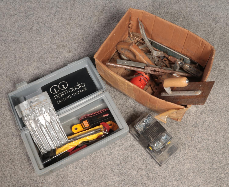 A box of tools. Includes wood boring set etc.