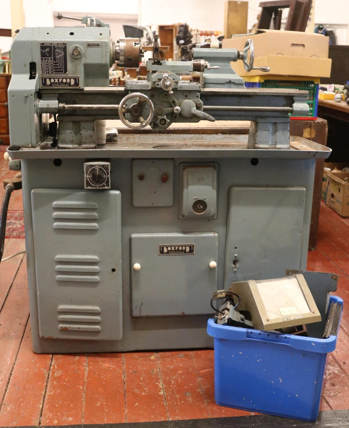 A 'Boxford' metal working lathe together with & box of spare parts. H:117cm,W:107cm,D:44cm.