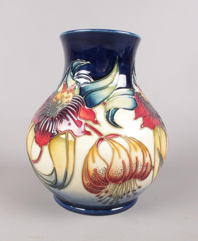 A Moorcroft 'Anna Lily' vase: Designed by Nicola Slaney. H:16cm. (Unboxed) Condition good. No