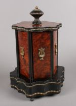 A Victorian burr walnut and ebony musical cigar dispenser, adorned with ormolu decoration. Good