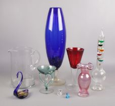 A collection of art glass. Includes Whitefriars jug, large blue glass vase etc.