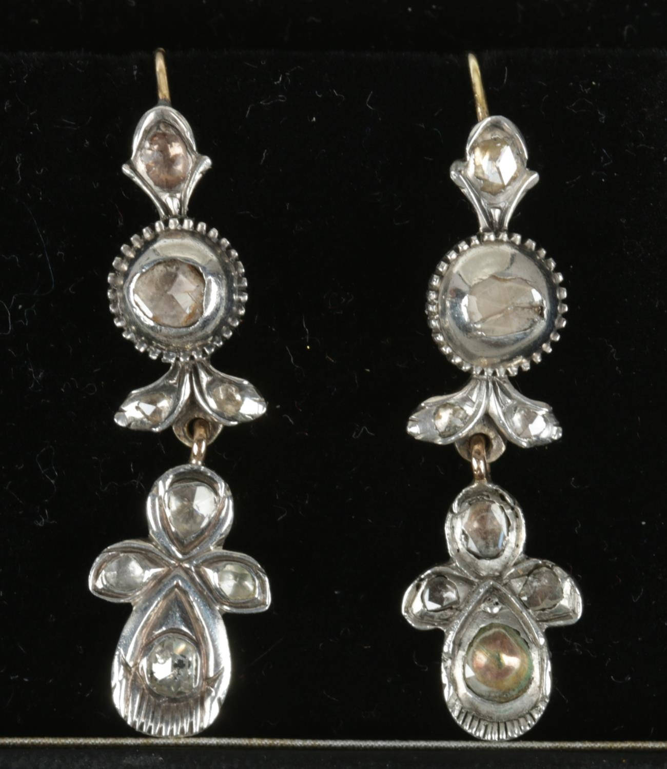 A pair of antique white metal and diamond drop earrings.