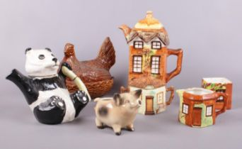 A group of ceramics. Beswick 'Panda' teapot, Portmeirion (oven to table) chicken lidded dish,