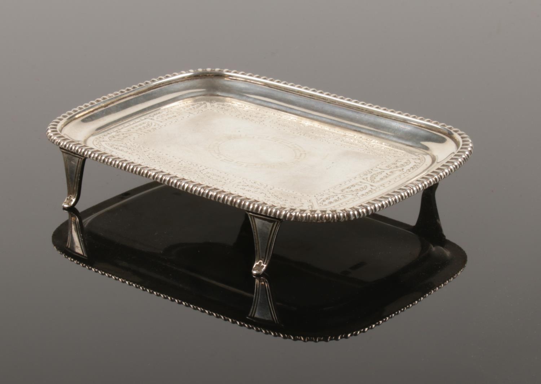 An Edwardian silver card tray. Assayed Sheffield 1903 by Thomas Bradbury & Sons Ltd.