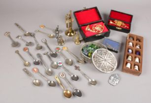 A group of collectables. Includes filigree box, collector's spoons, thimbles, miniature musical