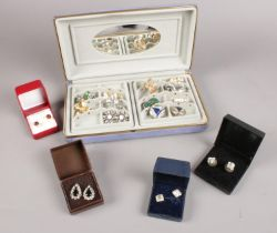 A collection of costume jewellery. Mainly earrings (clip on/stud), brooches, rings examples etc.