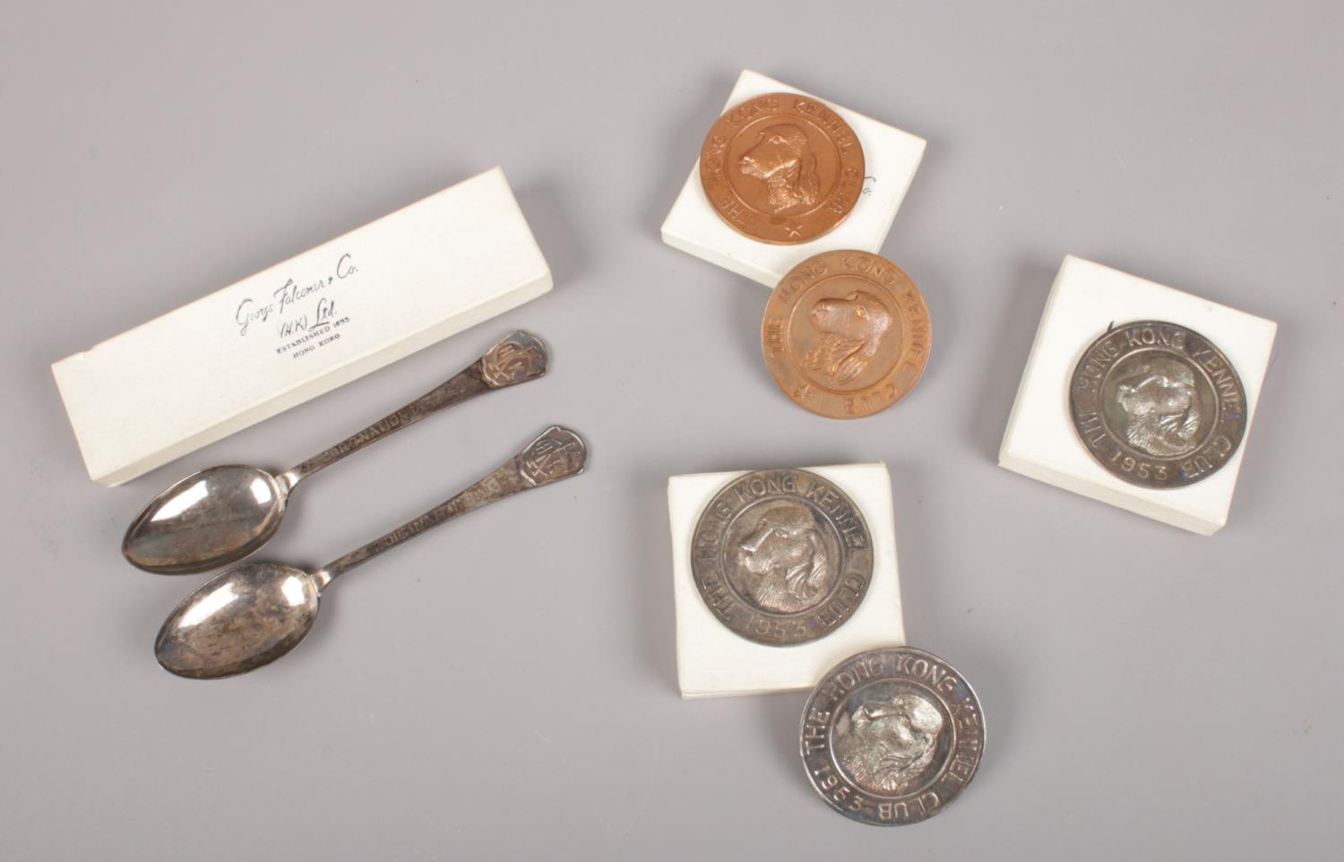 A collection of mainly silver items by George Falconer & Co, Hong Kong. Includes spoons and medals.