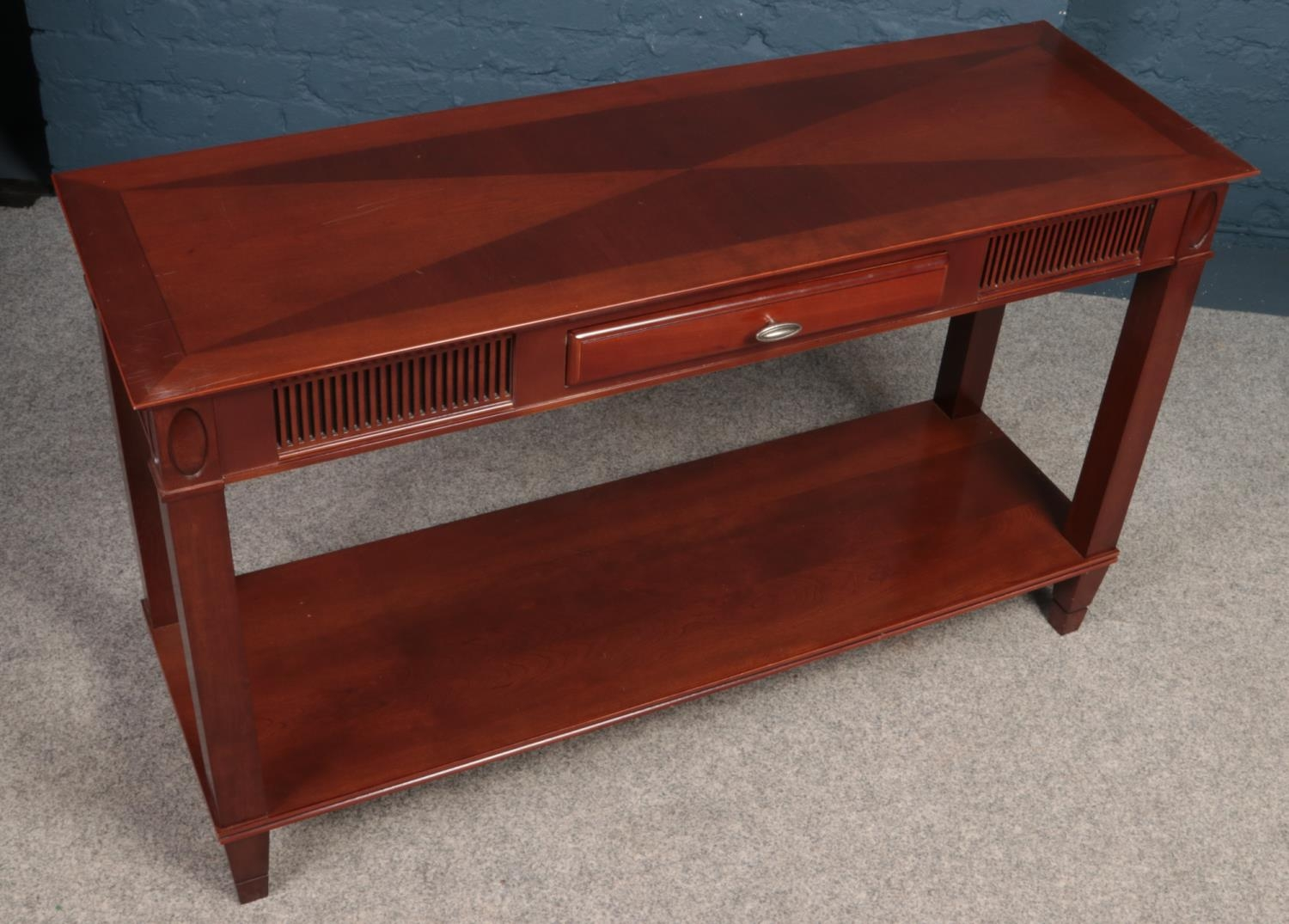 A Mahogany console table with central drawer. Made by (Theseira). H:71.5cm, W:120cm, Condition good. - Image 2 of 2