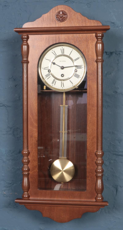 A modern William Widdop Mahogany pendulum wall clock.