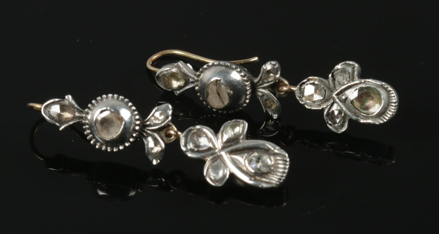 A pair of antique white metal and diamond drop earrings. - Image 2 of 2