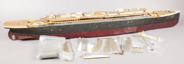 A wooden scratch build model of a ship. (107cm long)