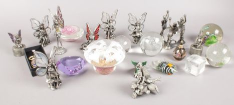 A box of mostly paperweights. Including pewter fairy examples, etc.