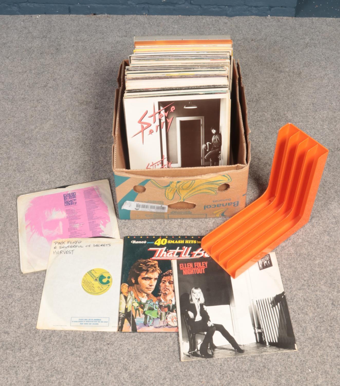 A box of LP records. Also includes retro record holder.