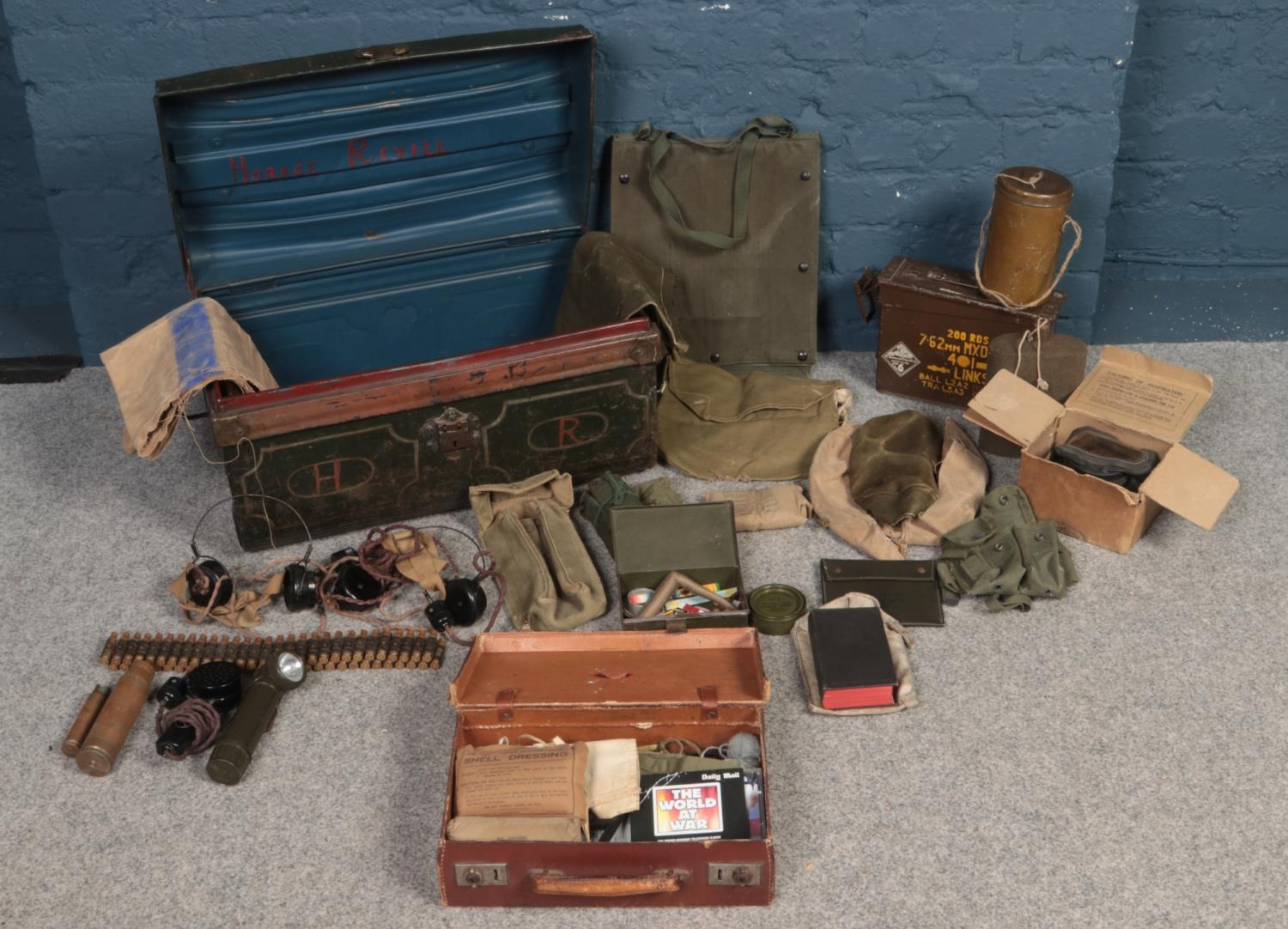 Militaria -A twin handle tin trunk with contents of WW2 military equipment. To include gas mask,