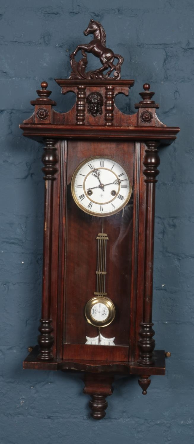 A Victorian eight day wall clock with Jungian's movement chiming on a coiled gong.
