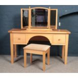 A collection of Beech bedroom furniture - comprising of a dressing table with matching stool,