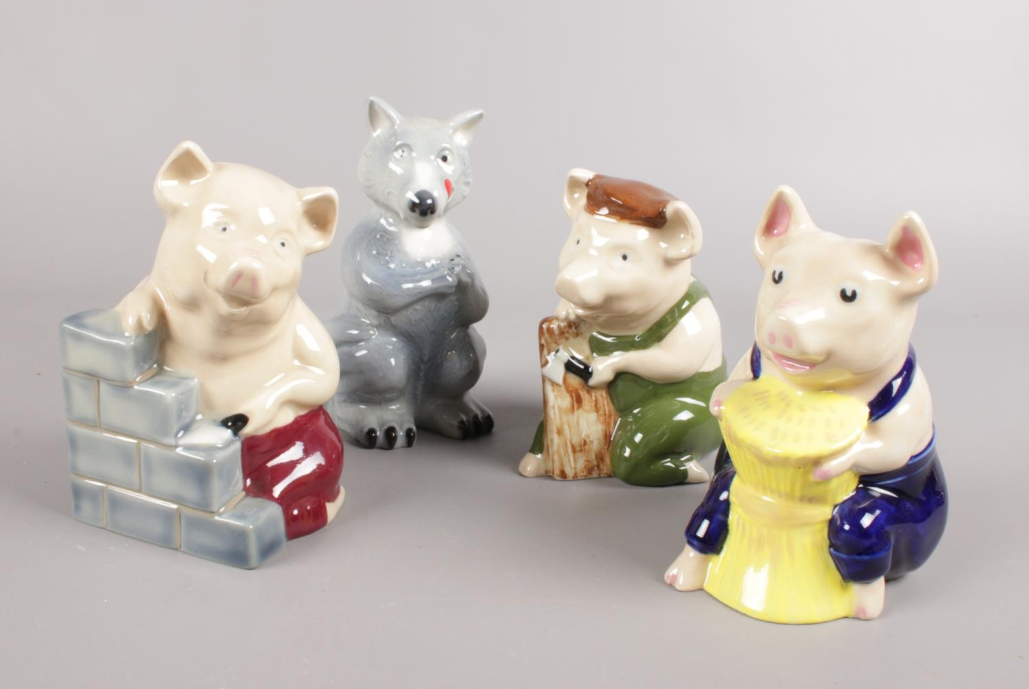 A collection of Wade Collector's Club figures. The Big Bad Wolf and Three Pigs.