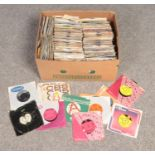 A box of single records. Includes promotional/demo examples.
