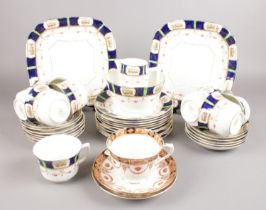 A collection of mainly Warwick bone china teawares. Also includes similar Royal Albert cup and two