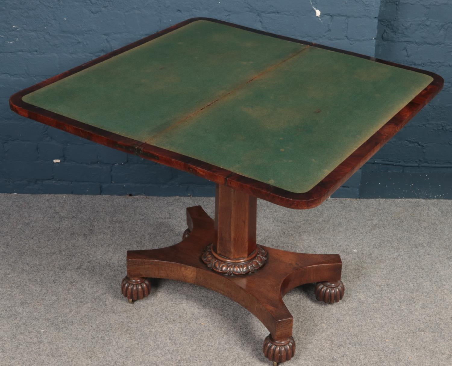 An early Victorian mahogany fold over card table. - Image 2 of 2