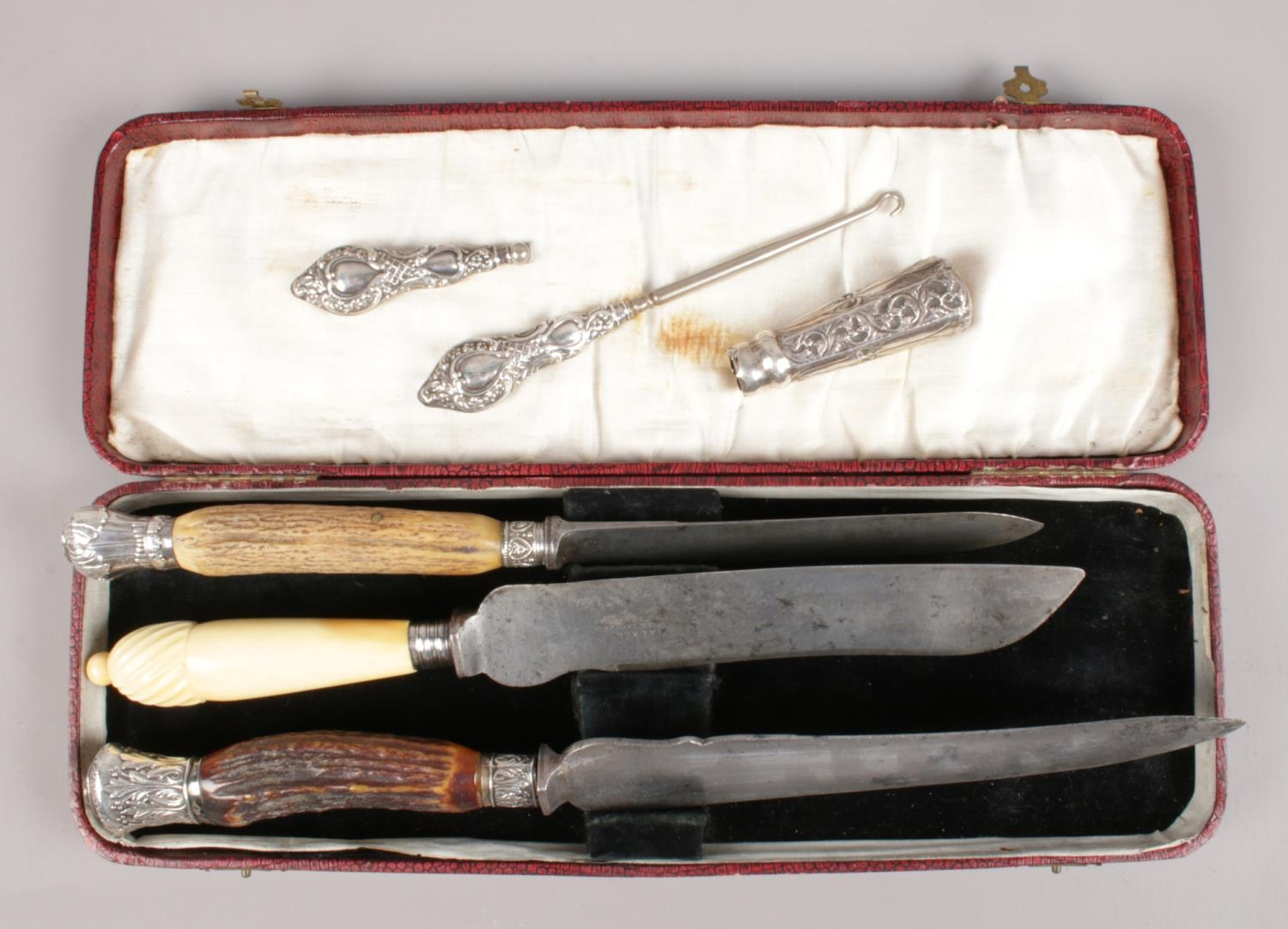 A collection of silver mounted/handled items. Includes carving knives, button hook etc.