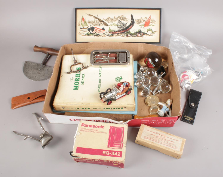 A box of collectables. Includes Corgi Chitty Chitty Bang Bang, vintage football pump, car workshop