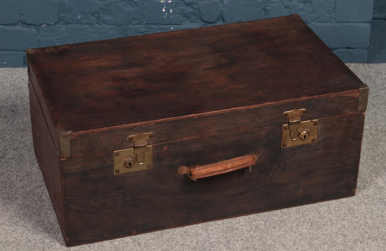 A vintage wooden suitcase.