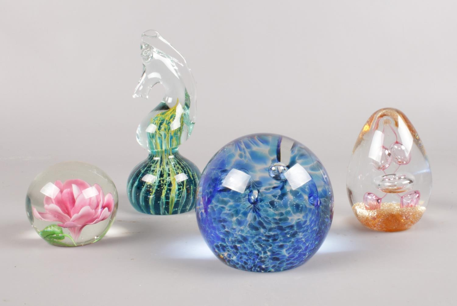 A collection of glass paperweights. Caithness 'Swirly Whirly', Royal Crest 'Apollo' examples etc. (