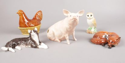 A group of Beswick figures. Pig sitting, Fox lying, Barn Owl, Hen in Basket, Long Haired Cat. (