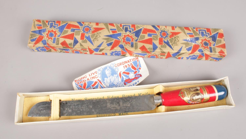 A boxed George VI coronation bread knife.