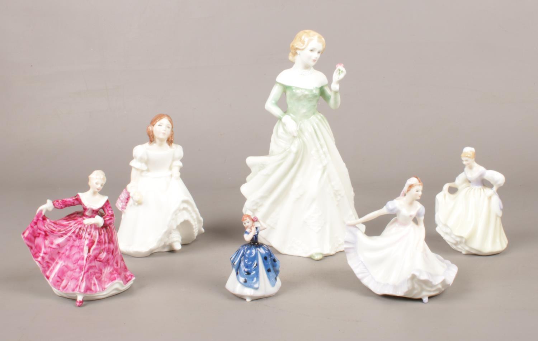 A group of Royal Doulton figurines. 'Lynsey' HN 3043, 'Ninette' HN 3215, 'Kirsty' HN 3213, 'Fair