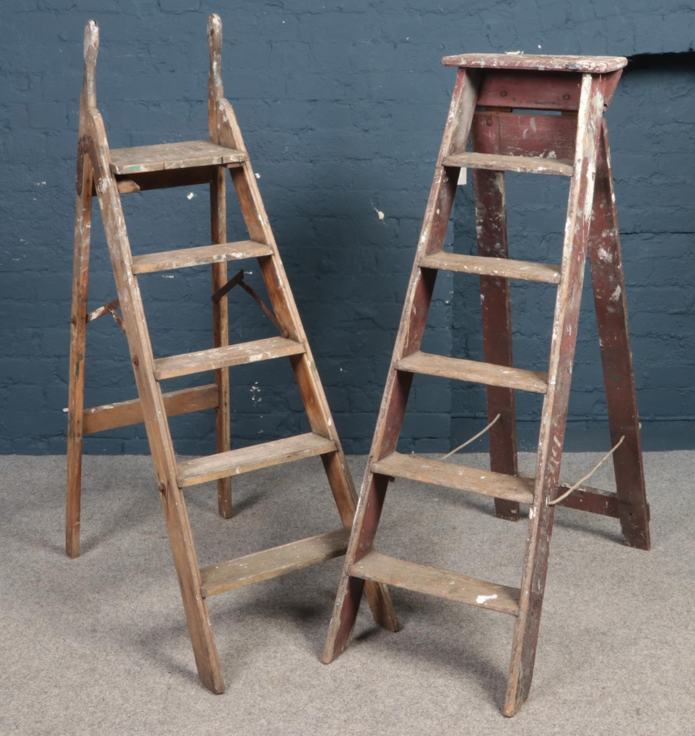 Two sets of decorators wooden step ladders.