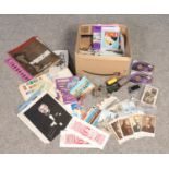 A box of miscellaneous, mainly ephemera. Includes Triang railway, postcards, stamps etc.
