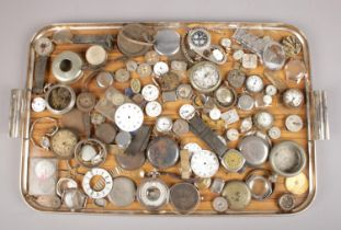 A tray of watch spares. Includes movements, dials, cases etc.