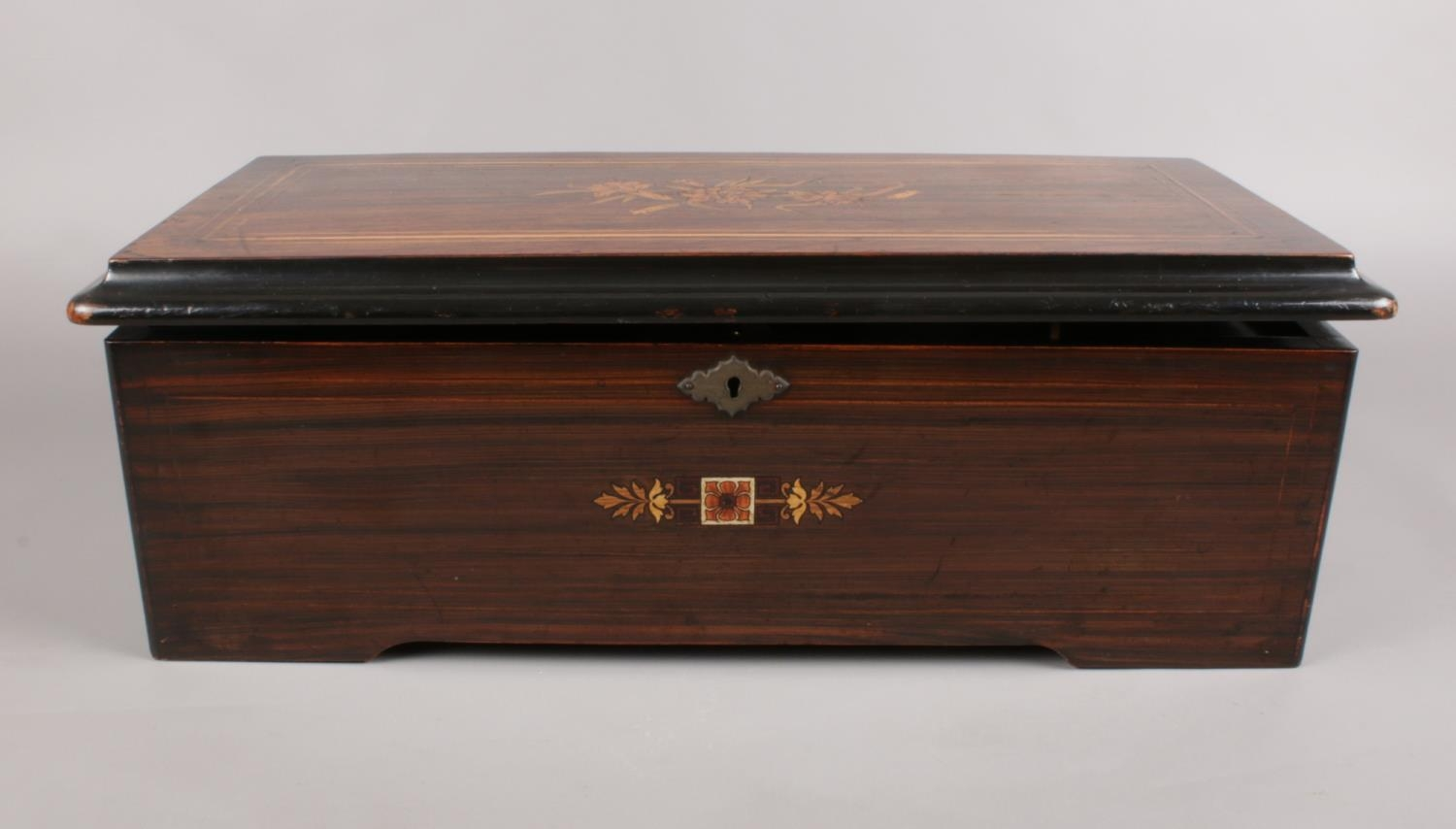 A late 18th C/Early 19th C Swiss inlaid Rosewood Music box. the hinged lid enclosing music box