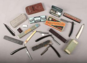 A box of collectable shaving items. Includes cut throat razors, blades, Rolls Razor etc.