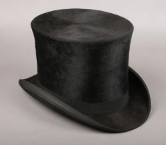 A R H Ramsden top hat. Front to back 20cm. Left to right 17cm.