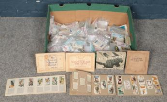 A large assortment of Brooke Bond, Wills's & Players cigarette cards together with seven albums.