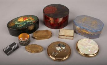 A small group of collectables. Includes pill boxes, compacts, lacquered boxes etc.