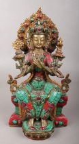 A bronze devotional figure with jewelled decoration. 28.5cm.