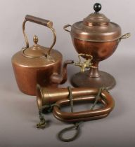 A copper samovar along with a copper kettle and bugle.