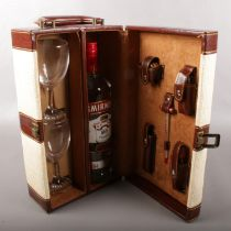 A wine carry case with contents. Includes full and sealed 1 litre bottle of Smirnoff vodka.