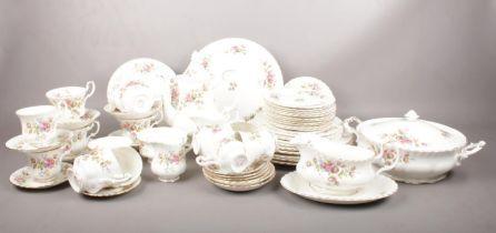 A Royal Albert ' Moss Rose' tea & dinner wares. 61 pieces. Coffee cups, Tea cups, saucers, dinner