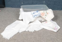 A box of assorted linens. Tablecloths, dollies etc.