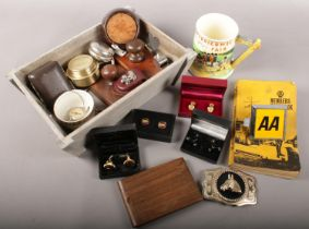 A box of collectables. Includes AA badge and member's handbook, cufflinks, Crown Devon Fieldings