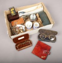 A box of collectables. Includes Bryant & May matchbox holder, vintage cased spectacles, military