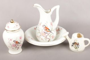 Four pieces of bird decorated ceramics. Including Arthur Wood jug & bowl, etc.