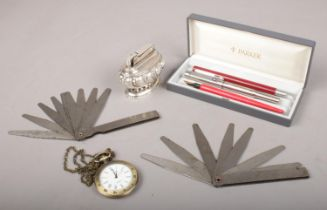 A small group of collectables. Includes pens, quartz pocket watch on chain, Ronson lighter etc.